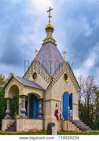 Orthodox chapel in south of Russia on gloomy sky background
