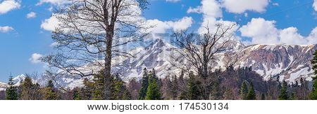 Winter Mountain Panorama With Blue Sky And Clouds