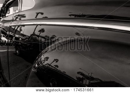 The driver's side of a 1940's classic American car in southern California.