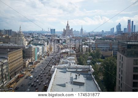 MOSCOW, RUSSIA - JUL 7, 2016: Daytime cars traffic and reconstruction of sidewalks at Garden Ring. Garden Ring is circular main street in the center of Moscow. Length - 15.6 km, width - 60-70 m.