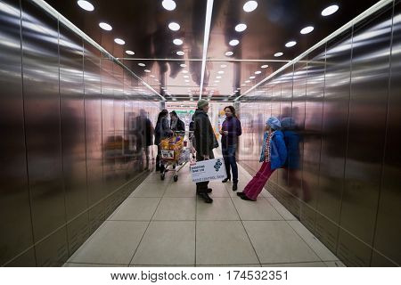MOSCOW, RUSSIA - APR 02, 2016: Elevator cabin with passengers in Aviapark trade center at Hodynskiy boulevard. Aviapark total area of 390 000 sq.m., shopping area - 230 000 sq.m.