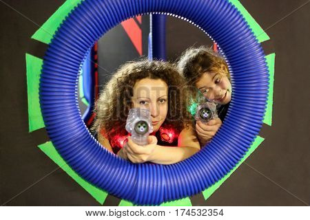 MOSCOW - DEC 13, 2014: Portrait of mother and daughter with a laser-automats in laser tag at the shopping center Capitol Vernadsky