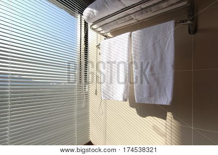 White Bath Towels On Towel Rack