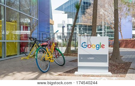 Mountain View CA USA - March 3 2017 - Google lobby sign and one bicycle parked in front of the entrance of Google headquarters building in Mountain View CA USA on March 3rd 2017.
