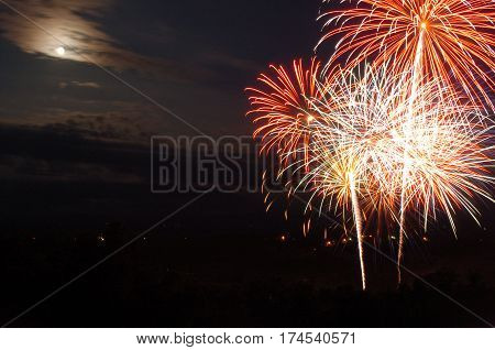 Fourth of July Celebration in Arkansas with Moon in Background and fireworks