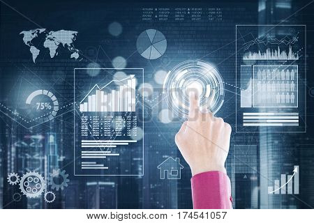 Hand of businessman pressing a virtual button with financial business on the futuristic screen