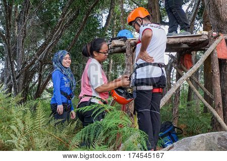 Labuan,Malaysia-Feb 12,2017:People with safety harness before enjoying on a flying fox in Labuan,Malaysia.There will be more ziplines in Malaysia,especially when there have so much natural resources & rainforest.