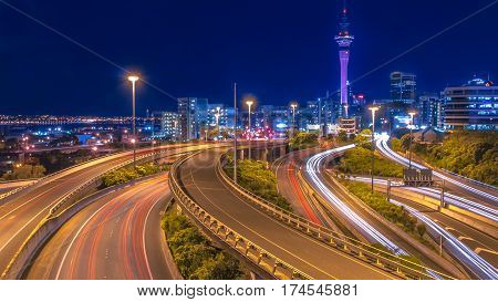 Night traffic with Auckland city centre on the horizon new zealand