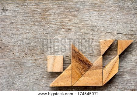 Wood tangram puzzle in human stumble and falling shape (Concept for business face the crisis)