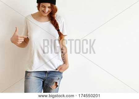 Fashion And Clothing Design Concept. Cheerful Happy Young Female With Ginger Hair And Tattoo Looking