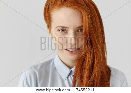 Close Up Portrait Of Charming Young Caucasian Woman With Freckles, Looking At Camera With Cute Shy S