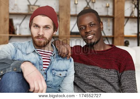 Homosexual Love And Relationships Concept. Interracial Gay Couple Relaxing At Cafe: African-american