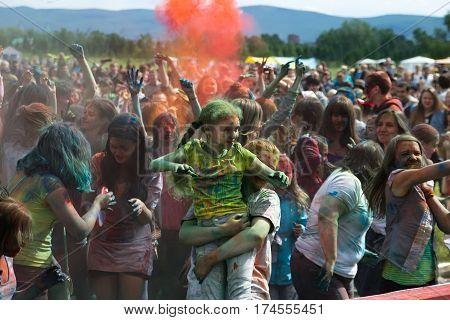 Baby taking bart in festival. KRASNOYARSK RUSSIA - JUNE 2015: People celebrate Holi-like part of festival Green