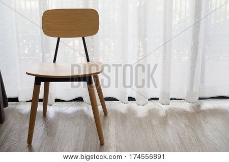 modern chair on white drape texture background and tile floor.