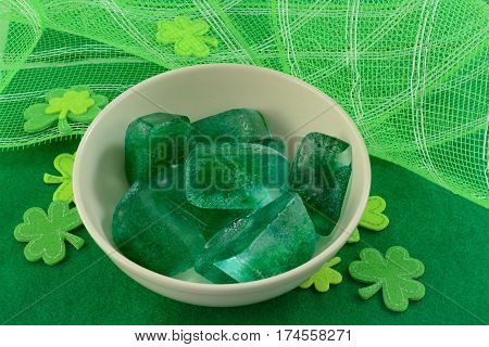 Green ice cubes with green shamrocks for Saint Patrick's Day