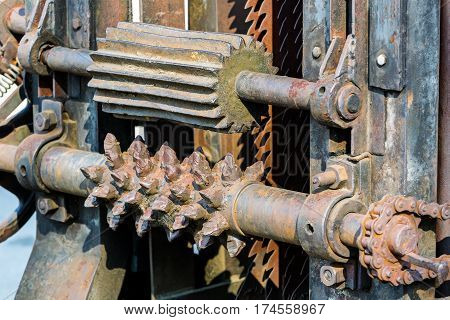 Detailed View Of Rusty Gears From Old Woodworking Machinery