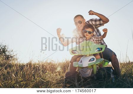 Father And Son Playing On The Road At The Day Time.