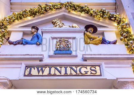 LONDON, ENGLAN - JANUARY 16, 2017 Old City Street Twinnings Chinese Tea Shop Nght London England. Chinese figurines to show the tea comes from China.