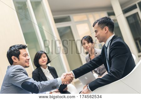 business people shake hand in the outdoor