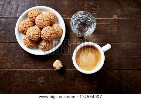 Cup of espresso, biscotti and a glass of water