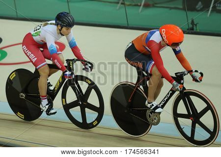 RIO DE JANEIRO, BRAZIL - AUGUST 13, 2016: Cyclists in action during Rio 2016 Olympics women's keirin first round heat 2 at the Rio Olympic Velodrome in the Barra Olympic Park in Rio de Janeiro