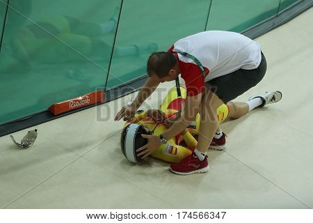 RIO DE JANEIRO, BRAZIL - AUGUST 13, 2016: Cyclist Tania Calvo of Spain crashes during Rio 2016 Olympics women's keirin first round heat 2 at the Rio Olympic Velodrome