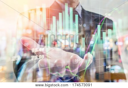 Business Man. Business put his hand forward and graph business. Business working and business people concept. Business city background. Business man over sunny office and business people background, business content, business background.