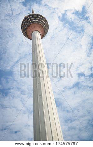 menara tv tower in kuala lumpur, malaysia with blue sky