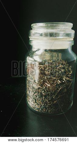 Green tea on black background,  herbal tea,  tea, loose leaf tea in a jar, Processed with VSCO