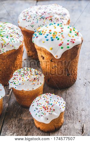 Several Kulich, A Traditional Russian Easter Bread, With Meringue And Colorful Sprinkles