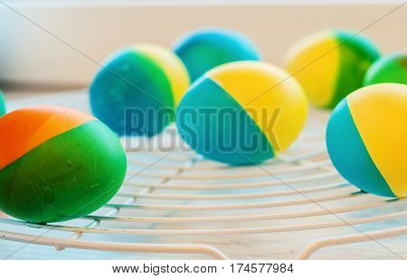 Easter Eggs Painted By Hand Yellow And Blue Lie On The Lattice
