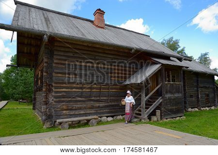 Velikiy Novgorod Russia - July 17 2016: Typical farmhouse in northern Russia. Open air Museum of Wooden Architecture of the 16th-19th centuries Vitoslavlitsy in Novgorod in Russia.