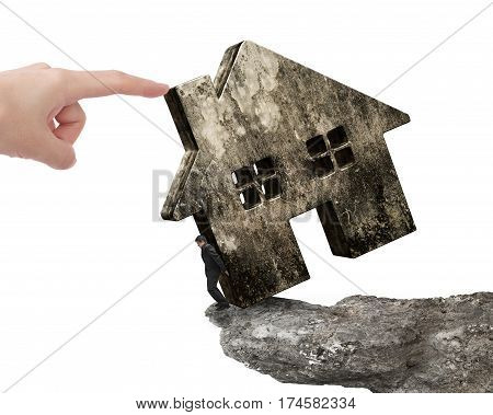 Man Holding Old House On Cliff Edge With Hand Pushing