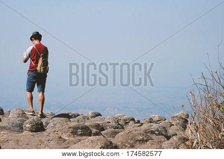 one man stand on the mountain at THE KNOB STONE GROUND,PHET CHA BUN, thailand