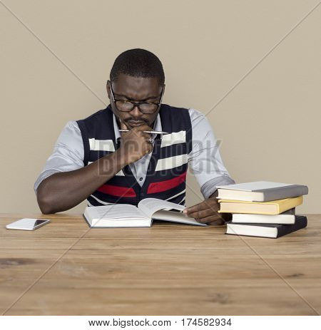 African Man Curious Thinking Reading Book Studio Portrait
