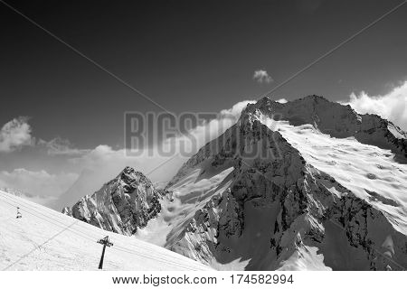 Black And White View On Ski Slope And Snow Mountain In Winter
