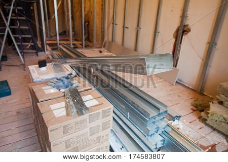Interior of apartment during on the renovation and construction ( making wall from gypsum plasterboard)
