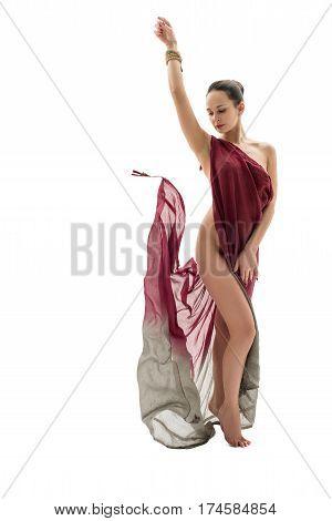 Pretty slim brunette wrapped in vinous cloth in graceful pose in studio