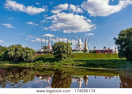 landscape temples houses and trees on a Sunny day with clouds on the banks of the Moscow river in Kolomna in the Moscow region