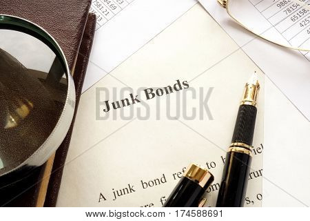Paper with a title junk bonds and other financial documents.