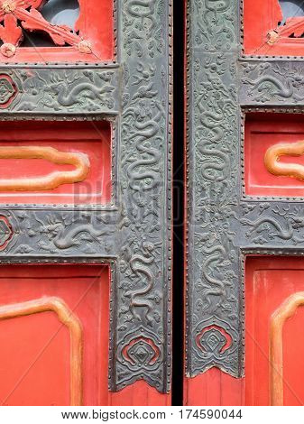 Vintage metal gilding with dragon motifs commonly seen on traditional oriental window or door frames.