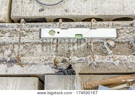 Construction tool Bubble spirit level is used to control reinforced concrete.