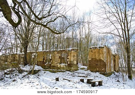 Historical manor estate ruins covered winter snow