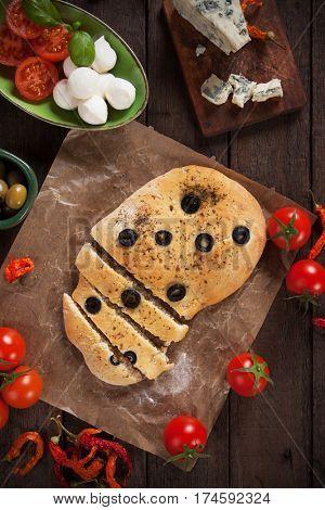 Italian focaccia flat bread similar to pizza with black olives