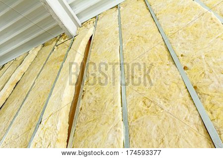 Galvanized steel joist is holding thermal insulation material rock wool.