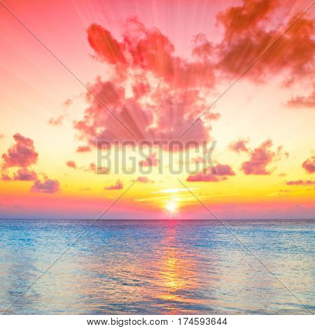 Tropical unset landscape over sea reflection background