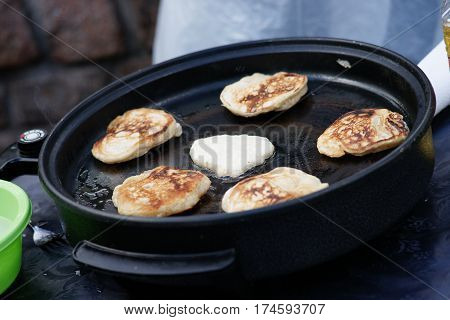 Photography of a fritters on a pan