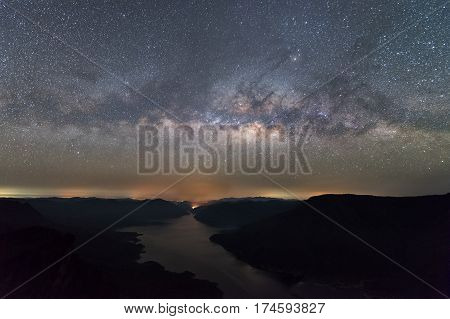Clearly Milky way above the lake and mountain. Pha Dang Luang view point Mae Ping National park.