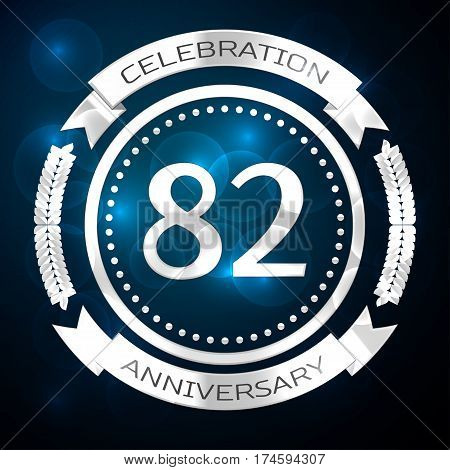 Eighty two years anniversary celebration with silver ring and ribbon on blue background. Vector illustration