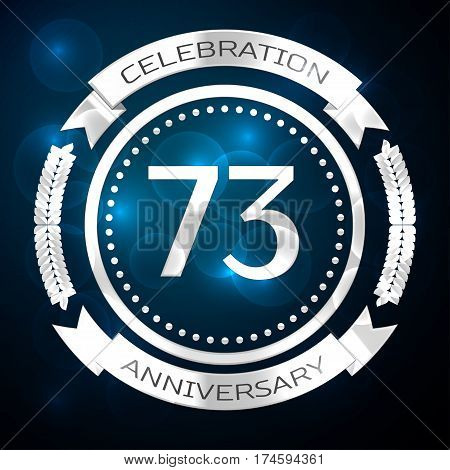 Seventy three years anniversary celebration with silver ring and ribbon on blue background. Vector illustration